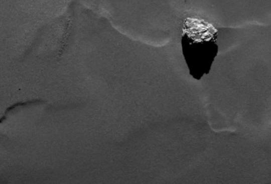 Close-up of the boulder Cheops as it casts a long shadow on the surface of comet 67P/Churyumov-Gerasimenko. Cheops has a size of approximately 45 meters and is the largest structure within an a group of boulders located on the lower side of the comet's larger lobe. The image was obtained on September 19th by Rosetta's scientific imaging system OSIRIS from a distance of 28.5 kilometers. One pixel in this image corresponds to 50 centimeters. <br /><br />