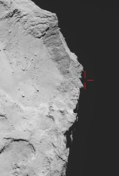 Rosetta's OSIRIS wide-angle camera captured this view of Comet 67P/Churyumov–Gerasimenko on 12 November 2014 at 17:18 GMT (onboard spacecraft time), with what is thought to be Philae above the rim of the large depression (marked). The image has been used to guide subsequent lander search efforts, and provides the basis for trajectory reconstructions.<br /><br />