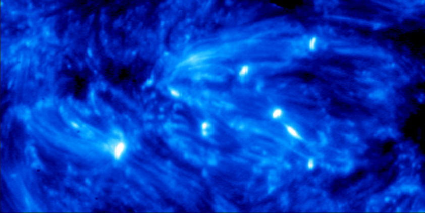 Hot explosions in an active region of the Sun. In this image of the photosphere that was obtained at the end of September 2013 with the help of IRIS, the explosions are the bright spots. The image shows a sector with a size of 50 000 kilometers by 25 000 kilometers.                                <br /><br />
