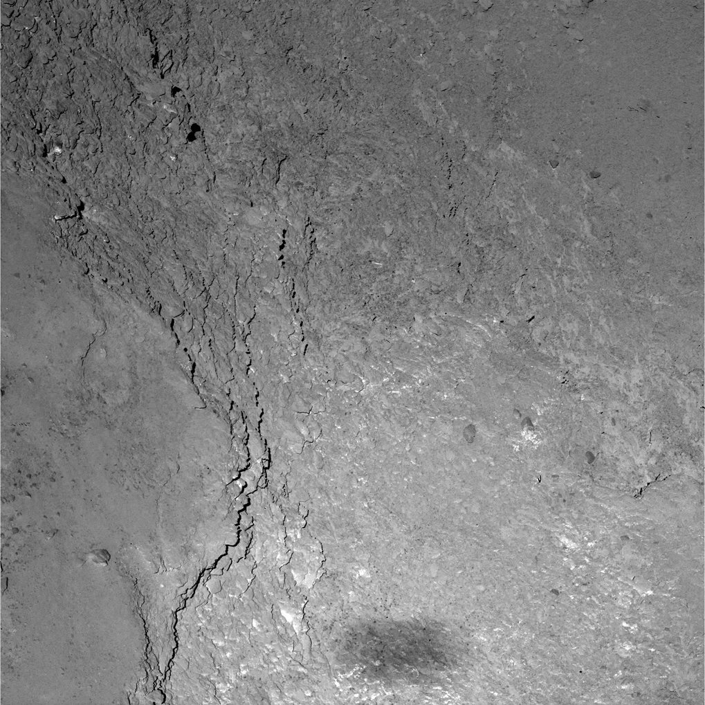 Close-up view of the Imhotep region on comet 67P/Churyumov-Gerasimenko caught by OSIRIS' Narrow Angle Camera during Rosetta's flyby on 14 February 2015. Only six kilometers separate Rosetta from the comet's surface leading to a resolution of 11 centimeters per pixel. At the bottom of the image Rosetta's shadow can be seen.  <br /><br />