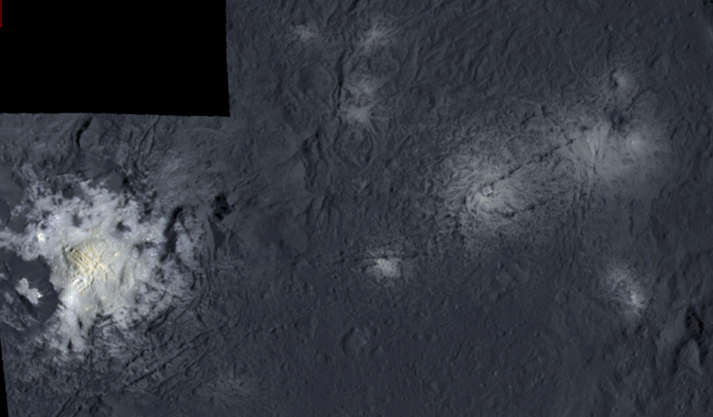 False color mosaic showing parts of Occator crater. The images were taken from a distance of 375 kilometers. The left side of the mosaic shows the central pit containing the brightest material on Ceres. It measures 11 kilometers in diameter and is partly surrounded by jagged mountains. In the middle of the pit a dome towers 400 meters high covered by fractures. It has a diameter of three kilometers. The right side of the mosaic shows further, less bright spots in Occator crater.